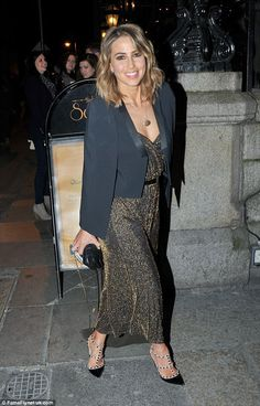 All that glitters: Fellow mentor Rachel Stevens wore a gold maxi dress topped with a black...