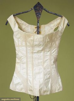 """Cotton corded corset, 1800-1825. Augusta Auctions: """"White tabby cotton w/ geometric pattern, bone eyelets, center front busk channel."""""""