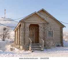 Small Wooden House | Russian wooden small house in the winter - stock photo