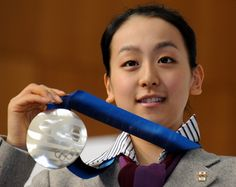 Mao Asada, showing her Silver medal to fellow school mates during the Triumphant Welcome Reception of her alma mater ー Chukyo University; sharing with all her Fellow Students the medal and sharing the Olympic experience she just had.. held at two o'clock 38mins. pm, March 3, 2010  in Toyota City, Aichi Prefecture. ・ Photo by Miki Takeuchi ・