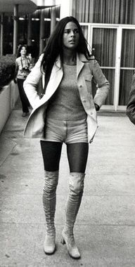 Actress, Ali MacGraw wearing hot pants in the 1970s. and over the knee boots..in WHITE..white boots were big in the 60s