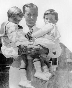 Joseph P. Kennedy with his sons Joe Jr and John Kennedy.