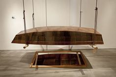 "Tony May,  R. C. Boat, 1975 Wood, paper, resin 18 x 44 x 96"" Courtesy of the Artist"