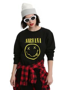 Formed in 1987, Nirvana became one of the biggest rock bands of all  time. Show your love for Kurt, Krist and Dave with black crewneck sweatshirt featuring the band's signature smiley logo screened on the front.   80% cotton; 20% polyester  Wash cold; dry low  Imported  Listed in junior sizes