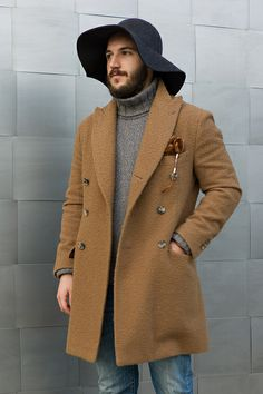 Digging this brushed wool coat and wide floppy brim fedora.