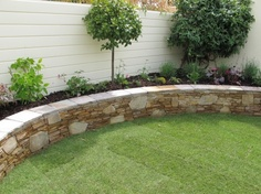 Flowerbed, wall, lawn combo