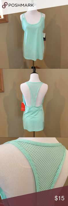 """NWT Zella Teal Racerback Tank Top New with tags teal racerback tank top from Zella. Purchased from Nordstrom. They are a few marks that look like dirt that should come off when washed. Both are pictured above. Otherwise no flaws. Color is best represented in the picture of the size tag. Size extra small and roughly 26.5"""" long. No trades and my listing price is firm. Zella Tops Tank Tops"""