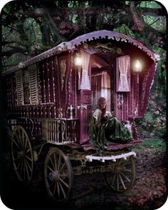 Yes here you find me sitting on the steps of my gypsy caravan. My beautiful cart horse Flyn has trotted off to the river for a drink and my gypsy king Rodrigo is fishing for our supper. Later we shall all feast on wild trout washed down with some delicious mead ;-) .....Hey it's raining here in the UK and I'm laying in bed while hubbie's just nipped down MacDonald for me egg muffin but hey a girl can dream lol!