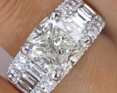 This is an engagement ring? I do! No it doesn't matter what he looks like, I DO! Stormy Estate Vintage Cushion Diamond Engagement by DiamondViolet Gemstone Jewelry, Diamond Jewelry, Jewelry Rings, Fine Jewelry, Jewelry Watches, Unique Jewelry, Jewelry Accessories, Love Ring, Dream Ring