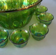 Evocative of a midsummer garden party - stunning green glass punch set has iridescent rainbow effect and in the Harvest Grape pattern. Use for punch o Punch Bowl Set, Indiana Glass, Pink And Green, Blue, Carnival Glass, Vintage China, Rainbows, Harvest, Bowls