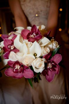purple/dark orchids bouquet  mauve and cream wedding flowers   Wedding flowers by Sophisticated Floral Designs. Portland, OR Marsala Pantone color of the year