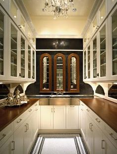 Traditional small space kitchen with black walls, white cabinets and timber features. Stunning!