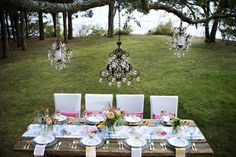 high tea - love the chandeliers hanging from the tree branch! #pretty #lovely #outdoors #tea #party