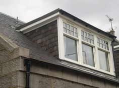 dormer window with tile hung cheeks