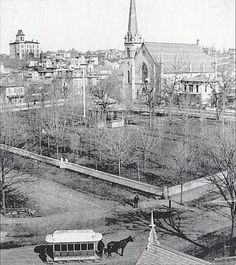 The view looks northeast across the park from the southwest corner of E. Fulton and Sheldon Ave. In the foreground is one of the horse drawn streetcars that came into service in the 1860s. The picket fence than encircles the park was installed by Thomas D