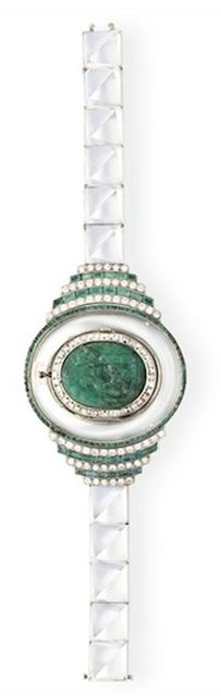 AN ART DECO ROCK CRYSTAL AND MULTI-GEM BRACELET-WATCH  Centering upon an oval plaque set with a green pâte de verre scene of two figures, opening to reveal a watch on the reverse side, mounted in 18k white and yellow gold, with French assay mark, watch circa 1910, band circa 1935,  Dial signed Dreicer & Co.; case with maker's mark for Vever