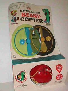 Oh my gosh.  I had this and loved it.  Mine had a dome and you put gumballs in it.  When the whirrly flew off and you bent down to pick it up, a piece of gum fell out.