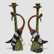 Pair of Hoopoe Candlestick holder ceramic sculptures, by Ardmore from South Africa.  Sculpted by Somandla Ntshalintshali, painted by Zinhle Nene.  At Creel & Gow.