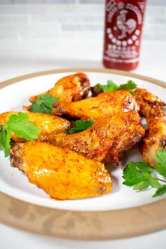 Sriracha buffalo wings are stupidly easy to make with just 3 simple ingredients (not including the chicken). Make fried chicken a breeze in the air fryer for crispy perfection and a quick gluten free sauce. Learn how to make the best tasty dinner tonight! Quick Chicken Recipes, Easy Asian Recipes, Indian Food Recipes, Ethnic Recipes, Side Dishes Easy, Vegetable Side Dishes, Gluten Free Sauces, Making Fried Chicken, Whole 30 Diet