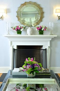 Mantel, Chic green & pink fireplace vignette with white fireplace, Buddha head statue, spider ...