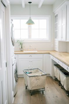 laundry-room-cabinets-ideas white cabinets wood countertops