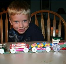 candy train. kid's bday decoration comes apart for favors or holiday version with peppermint wheels and holiday colored candy wrappers