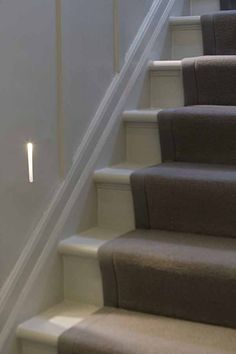 Supreme Boucle grey wool carpet taped stair runner fitted to grey painted staircase with grey wood paneling in private home in Wimbledon London Wood And Carpet Stairs, Concrete Stairs, Wood Stairs, Porch Flooring, Parquet Flooring, New Carpet, Wool Carpet, Sisal Carpet, Stair Art