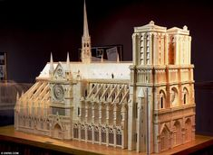 Labour of love: Patrick Acton, 59, spent 2,000 hours, used a further 2,000 toothpicks and a whopping 55 litres of wood glue to assemble the 7.5ft long by 5ft high structure