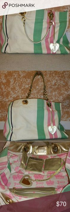 Juicy Couture XL Canvas Beach Bag Super spacious and super cute striped canvas beach bag with gold accent chain handle straps. Compartments for phone, lip-gloss, and credit cards + a zipped compartment. Closes with a magnet.   Please note there are a few blemishes on the back side of the bag and on the bottom (as shown in pictures) that I'm sure can probably be removed if spot-treated. Juicy Couture Bags Travel Bags