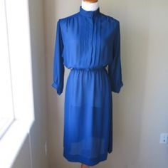 "Vintage Blue Pleated Top 50s Style Shirt Dress Flowing pleated blue 50s style dress. This dress is light and beautiful with your favorite leggings or vintage slip!   Approximate measurements:  Shoulders: 16.5""  Bust: 36""  Elastic Waist: 28-34""  Skirt Length: 26.5"" Vintage Dresses Long Sleeve"