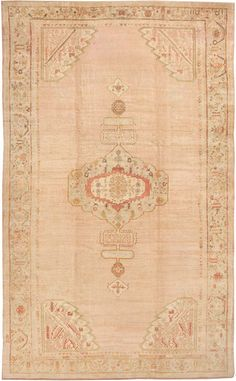 Antique Oushak Rug - #42360, Turkey, circa 1900 - An elegant scalloped medallion with cartouche finials of classical Turkish and Persian derivation is surrounded by cornerpieces within a spacious open field on this sumptuous antique Oushak.  The delicate vinescroll design of the main border recalls the interior ornamental detail and coloration within the medallion. The palette of soft salmon, celadon, and pale aubergine tones is set off to great effect by the exceptionally lustrous Angora…