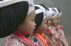 """Long Horn Miao girls in traditional costume to celebrate Flower Dance Festival."""