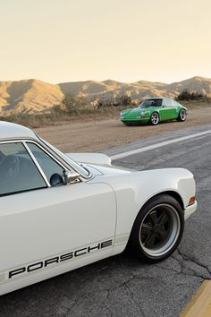 A pair of really nice 911's.    I wonder where the photo was taken?  LA?