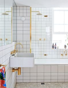 Bathroom With White Tile & Brass Faucet