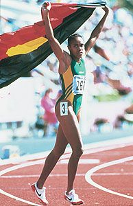 Cathy Freeman champion runner proudly waving her nations flag.