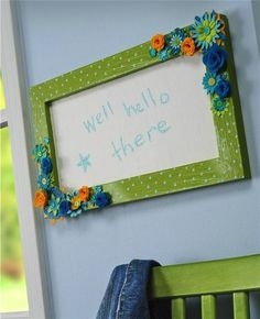 Turn an old frame into an upcycled floral DIY chalkboard