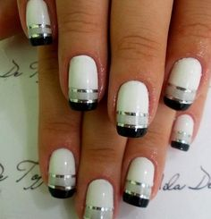Keep things interesting for prom with a black and white metallic striped manicure