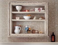 Repurpose an old wine crate or wooden box by adding shelves and a gilded frame. Finish with paint and it's ready to display toiletries or an interesting collection.