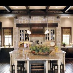 Dark stained cabinets with painted island