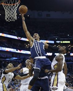 Oklahoma City Thunder guard Russell Westbrook (0) goes to the basket over New Orleans Pelicans guard Eric Gordon (10), forward Dante Cunningham, and guard Tyreke Evans, right, during the first half of an NBA basketball game in New Orleans, Wednesday, Feb. 4, 2015. (AP Photo/Gerald Herbert)