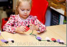 Stringing on Christmas lights to make words.