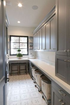 Laundry room cabinetry paint color is Benjamin Moore Trout Gray. Grey Laundry Rooms, Mudroom Laundry Room, Laundry Room Layouts, Laundry Room Remodel, Laundry Room Cabinets, Farmhouse Laundry Room, Grey Kitchen Cabinets, Laundry Room Organization, Laundry Room Design