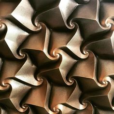"""Excentrica-B that just got """" Honorable mention"""" at JMM art exhibition. Yay! So happy! #origami #tessellation #corrugation #corrugated #paperfold #paper #paperart #spiral #curvedfold #ekaterinalukasheva #tiling #symmetry #papercraft #art #artwork"""