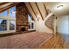 Fireplace, staircase, sunken living room.