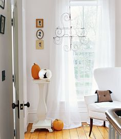 Pumpkin pedestal.  I would like to get a pedestal like this.  You could use it all year long by putting different stuff on it:)