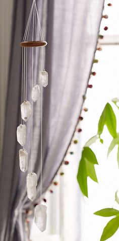 Spiritual Stone Decor - This White Quartz Crystal Mobile from Urban Outfitters is Bohemian (GALLERY) Crystals And Gemstones, Stones And Crystals, Gem Stones, Blue Crystals, Feng Shui, White Quartz Crystal, Clear Quartz, Diy Home Decor, Wind Chimes