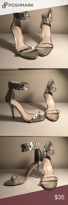 Silver Studded Stilettos Silver Studded Stilettos Size: 7 These heels are made for a more wider foot . Shoes Heels