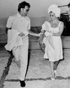 "Burton and Taylor arriving at Ischia. Taylor, who died last in 2011 at age 79, once said that the sound of Burton's voice made her melt.    ""Imagine having Richard Burton's voice in your ear while you are making love,"" she said. ""It drowned out the troubles, the sorrows; everything just melted away."""