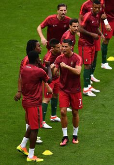 Cristiano Ronaldo of Portugal high fives with his team mates during the warm up prior to the UEFA EURO 2016 Final match between Portugal and France at Stade de France on July 10, 2016 in Paris, France.