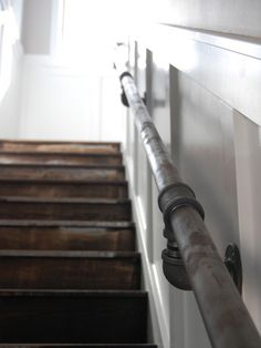galvanized pipe rail ~ great industrial look - also the paneling behind it dresses it up a bit